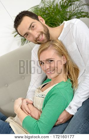 young couple resting in the sofa at home