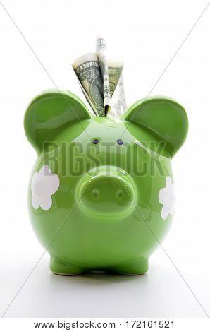 Green Piggy Bank With Us Dollar Bills