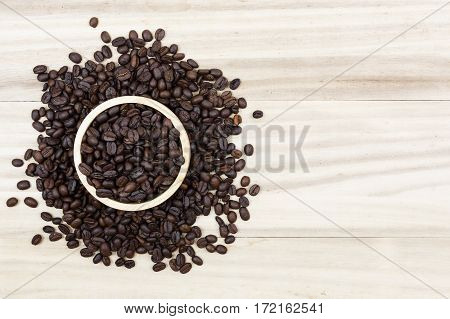coffee beans and coffee beans on wooden background