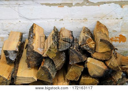 Stack of the firewood near a wall