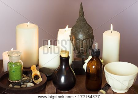 Massage of Spa of elements by candlelight on a table