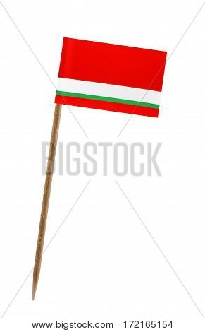 Tooth pick wit a small paper flag of Tajikistan