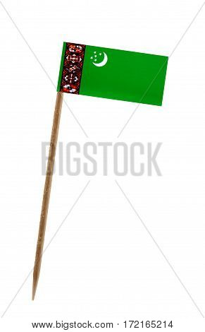 Tooth pick wit a small paper flag of Turkmenistan