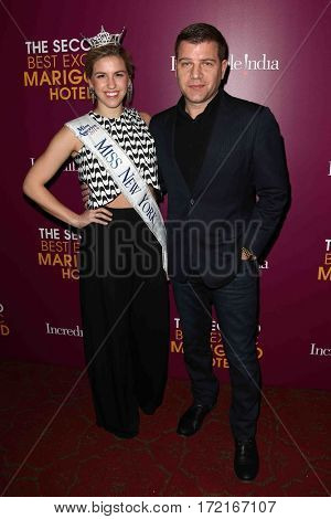 NEW YORK-MAR 3: Miss New York 2014 Jillian Tapper (L) and Tom Murro attend the premiere of