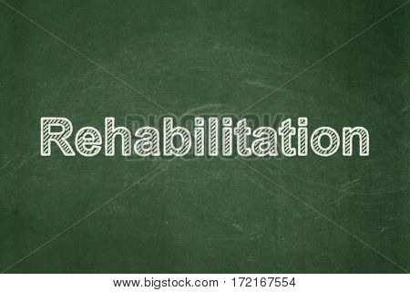 Healthcare concept: text Rehabilitation on Green chalkboard background