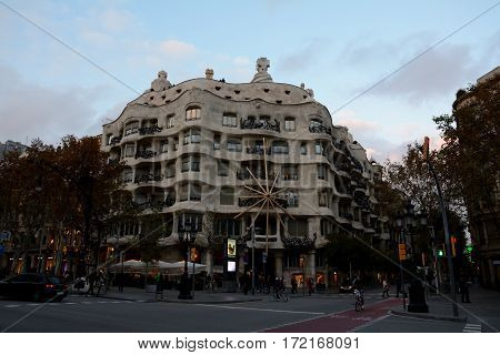 Barcelona Spain - December 3 2016: Famous La Pedrera Gaudi building in Barcelona city Spain. Unidentified people visible.