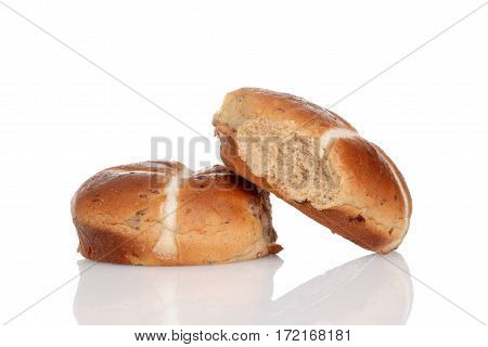 two hot cross buns with a white background