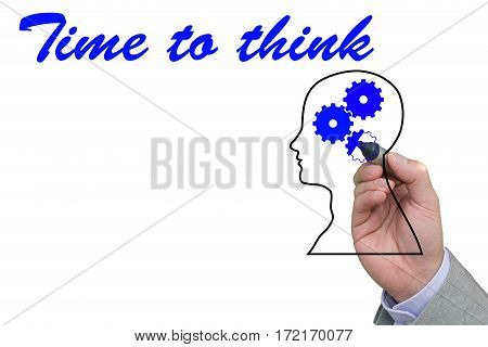 Hand of a businessman filling out a gear outline with a blue pen and the words time to think isolated on white