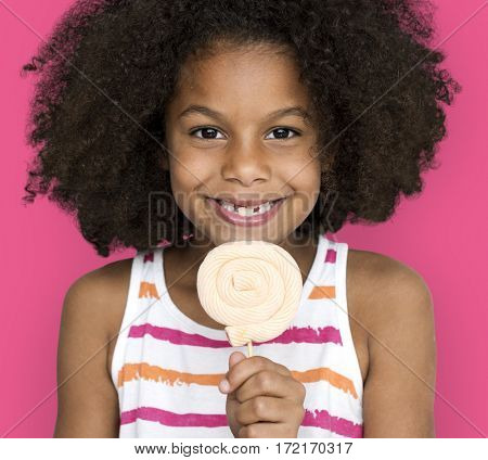 Little Girl Smiling Happiness Studio Portrait Sweet Lollipop