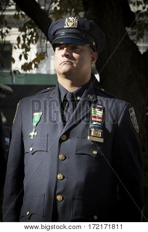 NEW YORK - 11 NOV 2016: 2016 Grand Marshal Nelson Vergara, Detective, NY Police Department, US Marine Corps vet at the Eternal Light Monument wreath laying ceremony, Madison Square Park, Veterans Day.