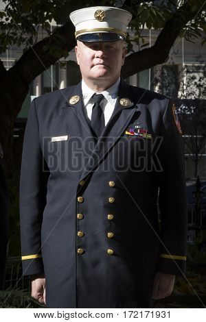 NEW YORK - 11 NOV 2016: 2016 Grand Marshal Joseph Duggan Jr., NY Fire Dept Battalion Chief, U.S. Army Veteran at the Eternal Light Monument wreath laying ceremony, Madison Square Park, Veterans Day.