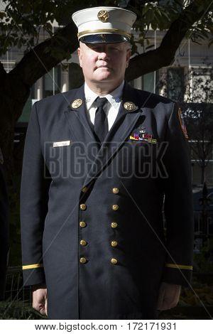 NEW YORK - 11 NOV 2016: 2016 Grand Marshal Joseph Duggan Jr., NY Fire Dept Battalion Chief, U.S. Army Veteran at the Eternal Light Monument wreath laying ceremony, Madison Square Park, Veterans Day.