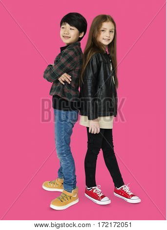 Boy and girl are posing on a shoot