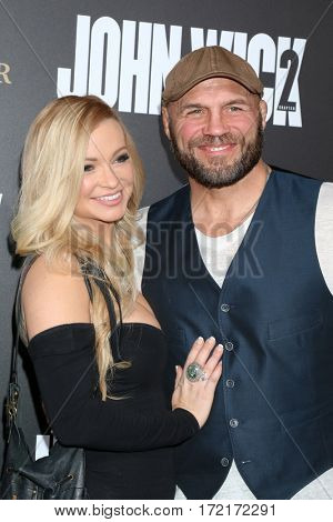 LOS ANGELES - JAN 30:  Mindy Robinson, Randy Couture at the
