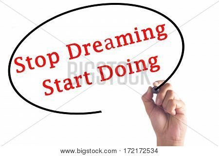 Hand Writing Stop Dreaming Start Doing On Transparent Board