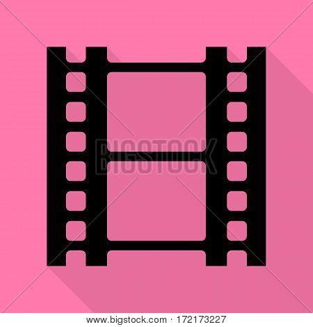 Reel of film sign. Black icon with flat style shadow path on pink background.