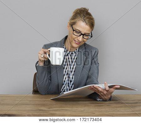 Businesswoman Reading Documents Coffee Drinks Working