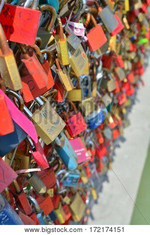 Salzburg Austria - April 25 2015: Love locks on the Makartsteg in Salzburg Austria. shot taken on april 25th 2015