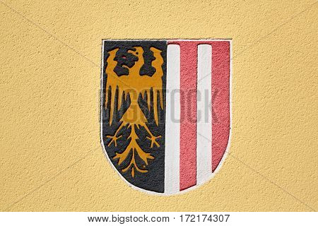Wappen of Upper Austria on a yellow wall
