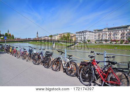 Salzburg Austria - April 25 2015: bicycles near the salzach river shore in salzburg austria. shot taken on april 25th 2015