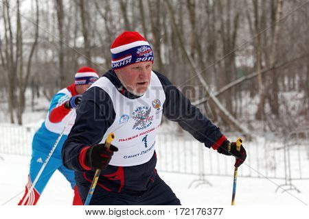 ST. PETERSBURG, RUSSIA - FEBRUARY 11, 2017: Vice-governor of St. Petersburg Vladimir Kirillov participating in the race Ski Track of Russia. This mass ski race is held annually since 1982