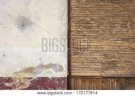 Old wooden and concrete walls separated the brown bar. The paint on the walls peel off