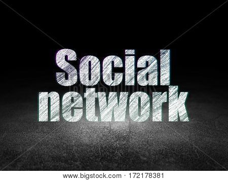 Social media concept: Glowing text Social Network in grunge dark room with Dirty Floor, black background