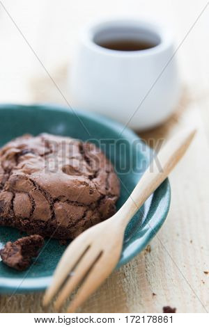 A piece of dark chocolate cookie with hot hea