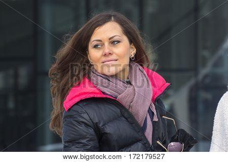 Women Posing On Urban Background