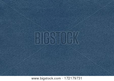 background and abstract grained texture of textile material or fabric of blue color