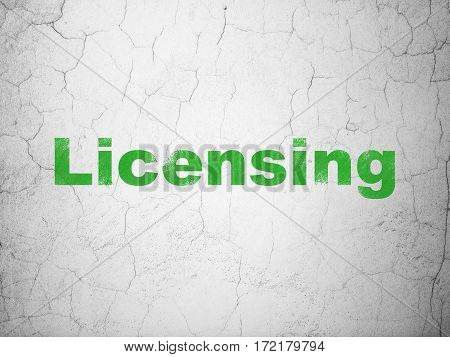 Law concept: Green Licensing on textured concrete wall background