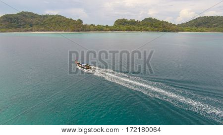 Amazing view to boat sailing in open sea at windy day. Drone view - birds eye angle. - Boost up color Processing.