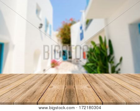 Wooden board empty table in front of blurred hotel building background. Perspective brown wood over blur hotel - can be used for display or montage your products.Mock up for display of product.