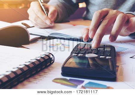 Close Up Hand Man Doing Finance And Calculate On Desk About Cost At Home Office.