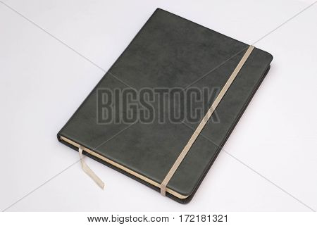 Grey cover of notebook with whit background.