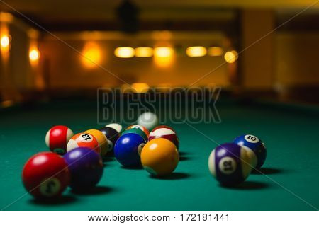 Billiard balls in a pool table. game