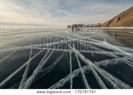 People go on the ice of Lake Baikal