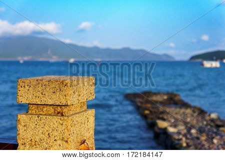 Old Stone Pier And Blue Sea