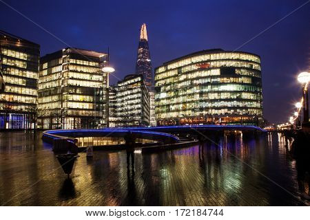 night cityscape of London with office buildings, the Shard and new City Hall