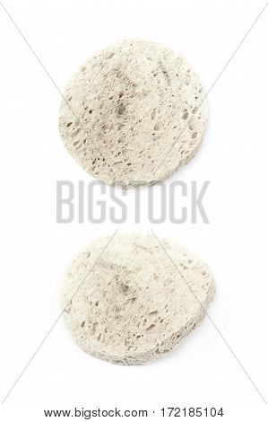 Used make-up cleaning round sponge isolated over the white background, set of two different foreshortenings