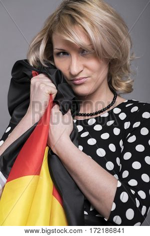 Grieving germanium, Young beautiful woman wrapped in the German flag