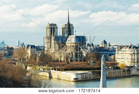 Scenic view of Notre-Dame de Paris with Saint-Louis and Cite islands on a bright day.