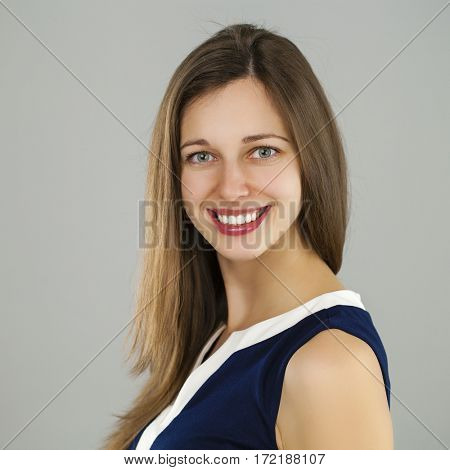 Happy Beautiful brunette woman face close up portrait young, isolated on gray background