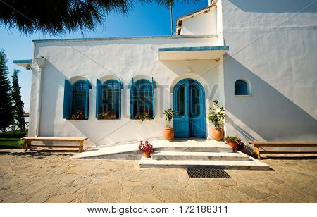 Traditional vintage building in Greece. Blue sky and white walls.