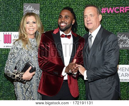 LOS ANGELES - FEB 16:  Jason Derulo, Tom Hanks and Rita Wilson arrives for the An Unforgettable Evening on February 16, 2017 in Beverly Hills, CA