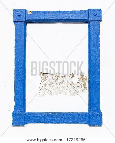 a blue frame on a white wall