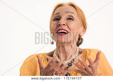 Senior woman portrait. Lady talking on white background. Public speaking tips.