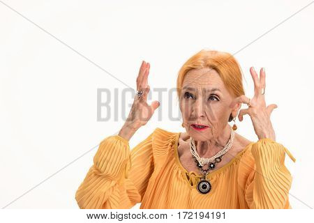 Annoyed woman isolated. Stressed old lady. How to cope with stress.