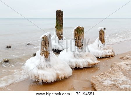 Ice on the breakwater in the form of skirts in the Baltic Sea