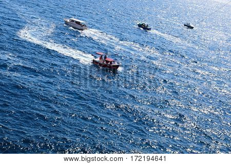 Four small pleasure boat are sailing on the sea. Marine taxi